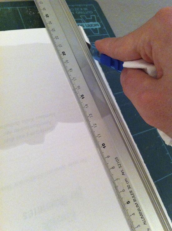 Use the other side of the ruler where it is higher. You do not need to measure, you need a high elevation so that the blade does not jump over the ruler.